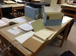 A thing of beauty to a research nerd: Full desk of archival material to read!