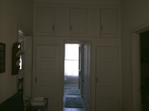 The built-in cabinets over the door are original to the house; this doorway probably led to a small bedroom instead of the bathroom you see today.
