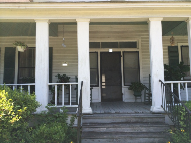 I sat on the porch of Emmett's childhood home, next to one of the columns.