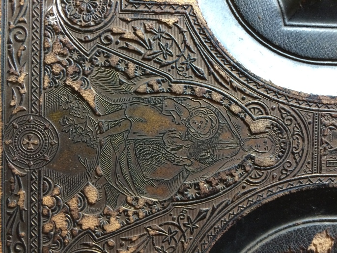 Some of the detail on the cover, which features impressed Roman Catholic symbols.