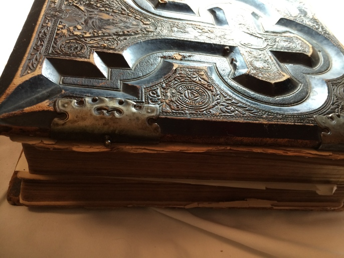 One of the covers still has brass closure clasps. As you can see, also, a number of the pages are separated from the binding. Most of the pages are attached, though the original binding is coming apart.