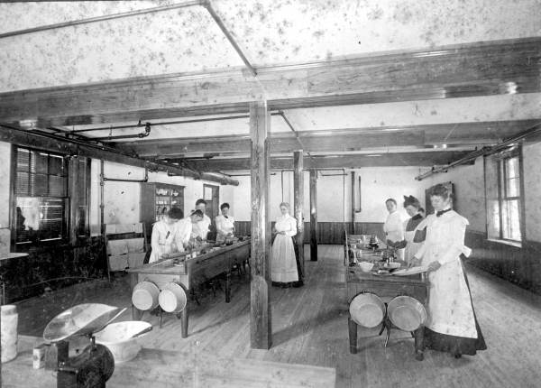Mrs. G. Prentice Carson is the first on the left, doing something 'domestic' in the Domestic Science Lab, basement of Flagler Hall, Stetson U. Image source: Florida Memory.com