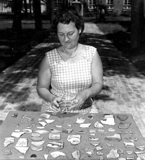 Leora M. Sutton, looking over pottery pieces from an excavation in Pensacola. Source: State Archives of Florida, Florida Memory, http://floridamemory.com/items/show/84028