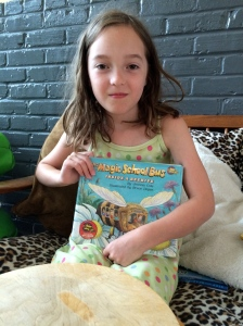 My youngest daughter and a favorite library book: Great facts about bees!