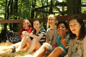 Sage (far right) and her friends on a hayride. Yep, she's having fun. Source: BRR