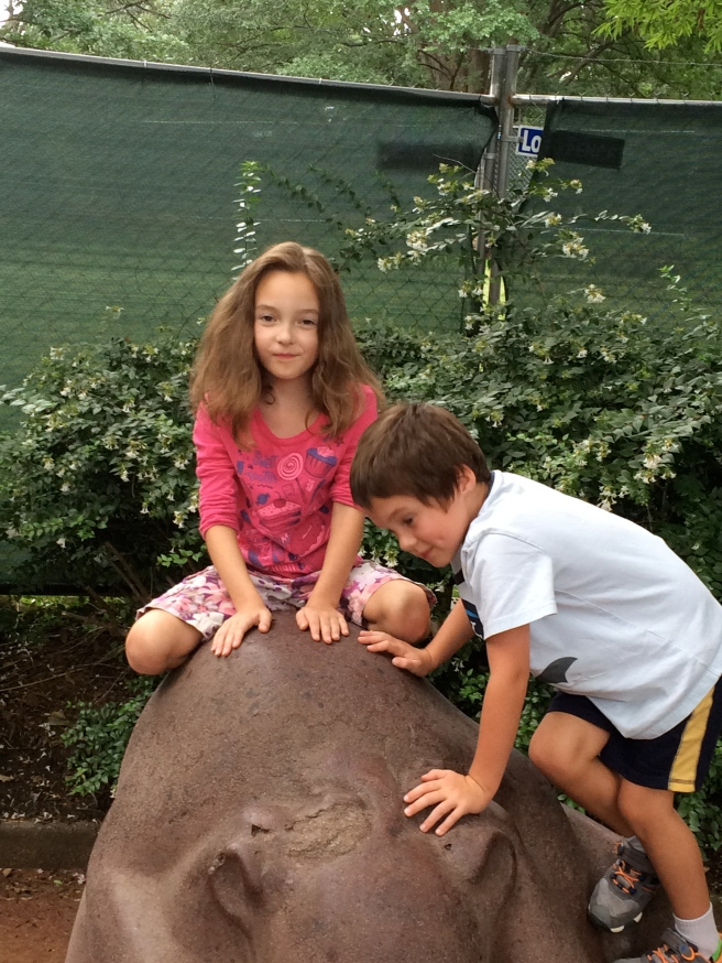 Zora and her brother on the stone bear at the National Zoo.