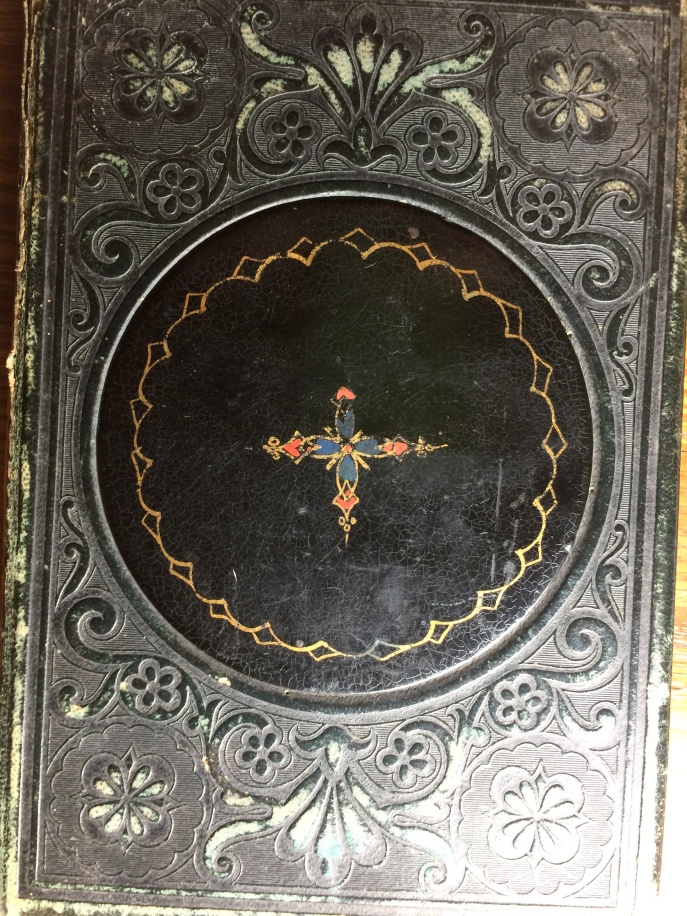 Here's the back of the book. The central inlay is not ceramic, but it seems to be an enameled wood, perhaps? I'm not sure. It is in great shape for something that is about 160 years old.