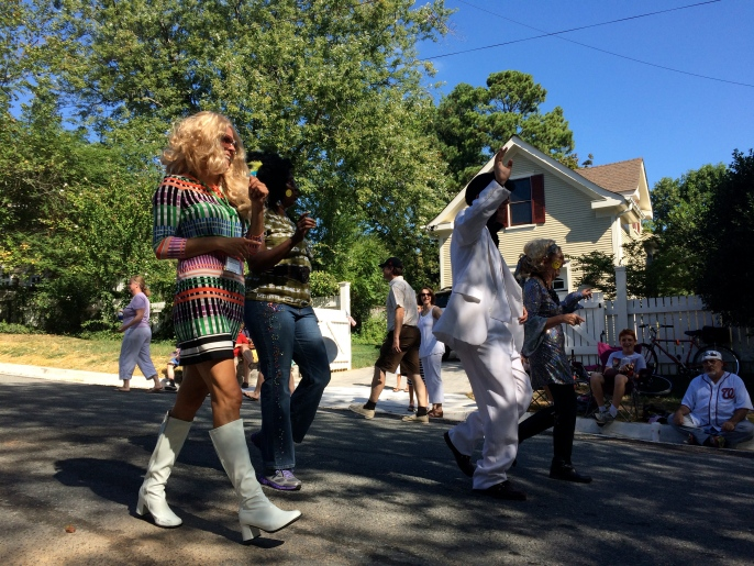 A bunch of crazy youthful hippies, with Elvis, of course. What's a parade without Elvis?