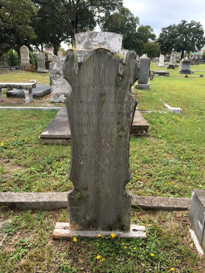 This is a wooden marker. Nancy thought it cypress. Great condition for its age.