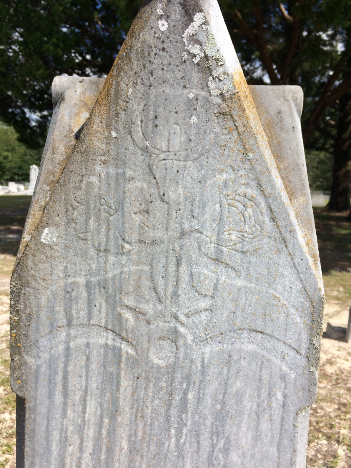 It's a better image of the carving on this stone. The rest of the back of Elizabeth's stone is smooth. No additional words.