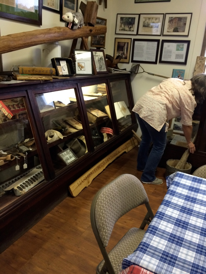 Dorothy moving artifacts in preparation to opening up a glass display case! I talked her out of it for the time being. It was too heavy, and there wasn't enough time. But I got a rain check.