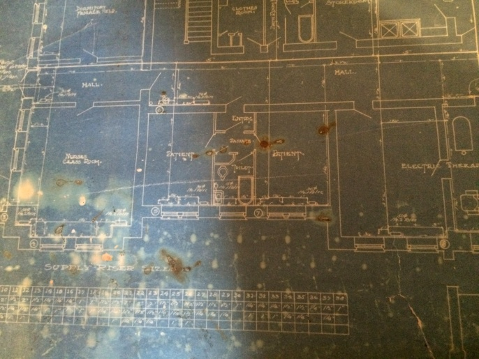 Notice the two patient rooms in the blueprint. These are the only rooms in the hospital with a designated foyer and private passage, which supports the newspaper report from 1915 where Dr. S.R. Mallory discussed the two hospital rooms in the basement set aside for the treatment of inebriates.