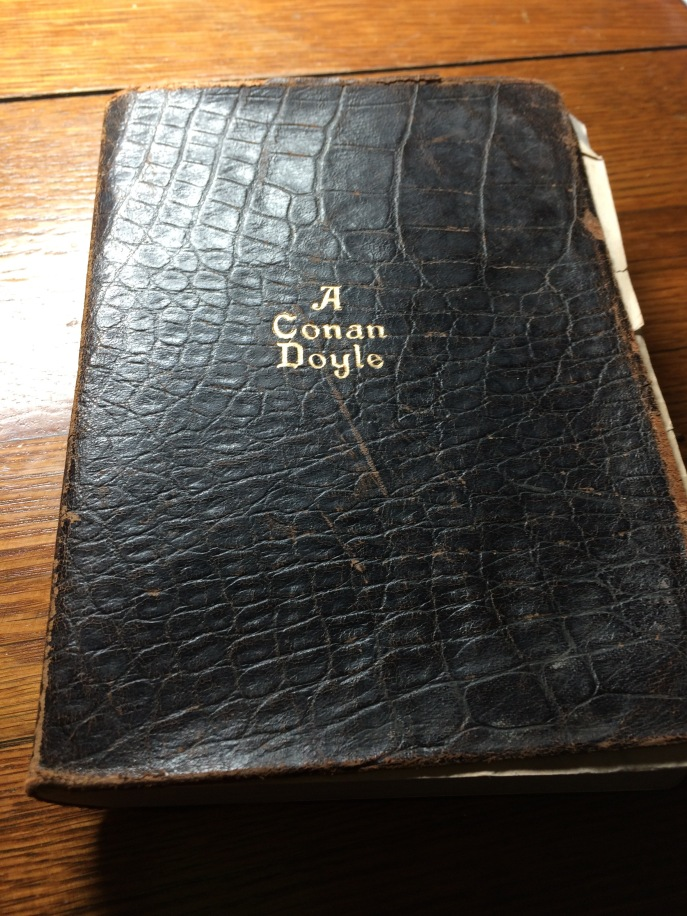 The cover is leather and gilded. Worn, well read, well loved.