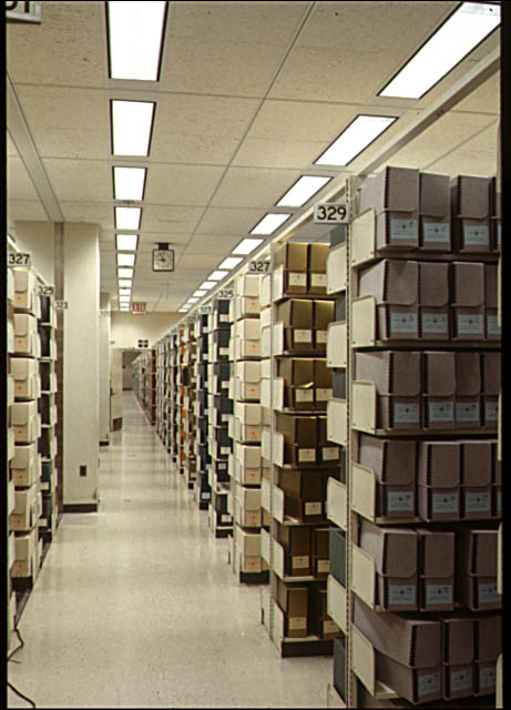 This is what it looks like in the stacks, folks. I wasn't allowed to take a photo while I was in there, but it does look just like this, many rows, many rooms. Most of this is not digitized. Source: LOC