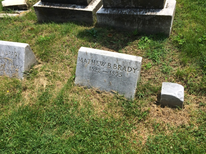 Brady's original stone, which is the at the top of the grave. The more recent stone is at the foot of the grave.