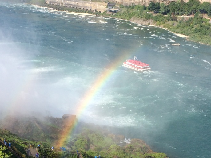 The American-side tourist boat, the Maid of the Mist, is blue. The Canadian-side tourist boat, the Hornblower, is red.