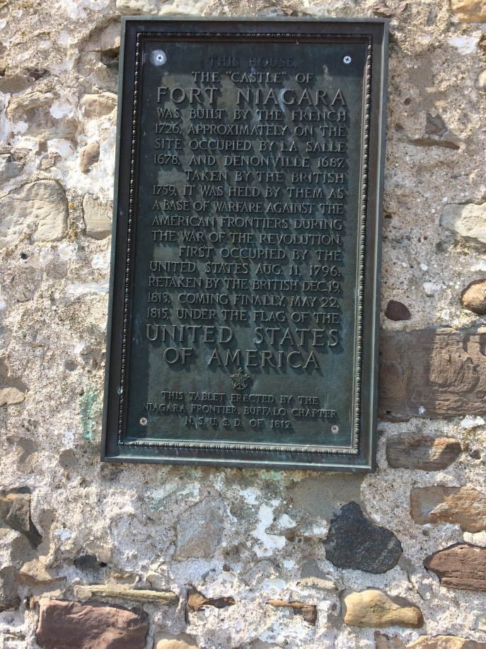 The plaque on the castle wall.