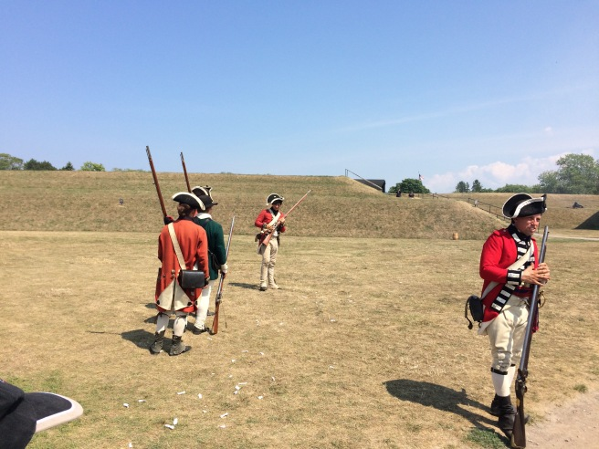 King George's loyal soldiers doing target practice at a barrel at Ft. Niagara, New York. These brave souls were wearing period costumes of all natural fibers (i.e., wool, primarily, and cotton) in 95-degree heat.