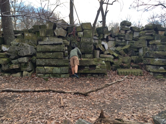 My husband walking among the aisles of stone.