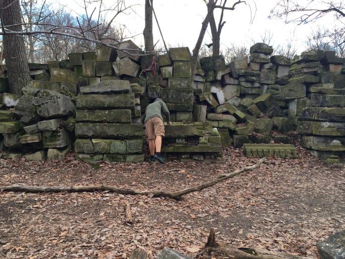 My husband walking among the aisles of stone.